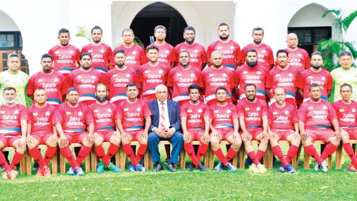 The touring Zahira Veterans soccer team: 1st row seated from left: M S K Namiz, T J Cuncheer, Naina Mohamed (Coach), Shazil Shaifdeen, Sharan Laffir  (Captain), Feroz Inham  (Chief De Mission), Niyas Aboobucker, Irfan Alavi, M. M. Amanullha, T A Rasif, M T M Shabeer, T Hashimdeen. Middle row standing from left: Jawfer-us Sadiq, M S M Imran, M S M Rizvi, Fahad Anwer, Nazly Nizam, M H M Hunais, M.l.M. Farhan,M S M Farzan, M I M Irfan, Yazir Khan, Imran Tham. Back row standing from left: M S M Imthynam, F M Na