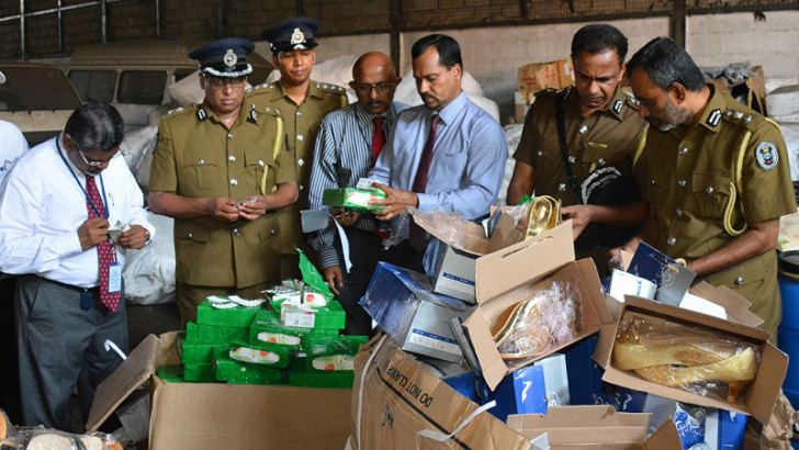 Customs officials inspecting the illegal consignment. Picture by Sarath Peiris.