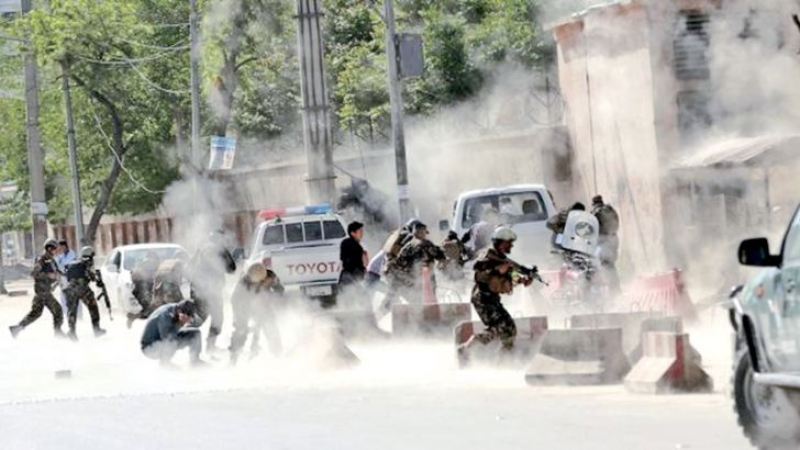 Security Forces run from the site of a suicide attack after the second bombing in Kabul, Afghanistan, on Monday.