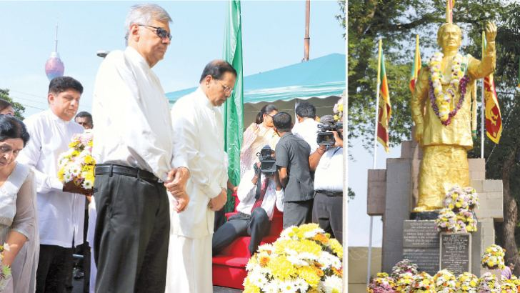 President Maithripala Sirisena and Prime Minister Ranil Wickremesinghe laying floral tributes in front of the late President Ranasinghe Premadasa's statue. Pictures by Saman Sri Wedage and Chinthaka Kumarasinghe.