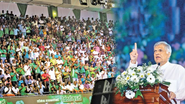 Prime Minister and United National Party Leader Ranil Wickremesinghe addressing the UNP May Day Rally at the Sugathadasa Indoor Stadium in Colombo yesterday.  Pictures by Rukmal Gamage and Hirantha Gunathillaka