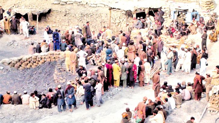 Pakistani miners gather outside a collapsed mine in the Marwaarh area.