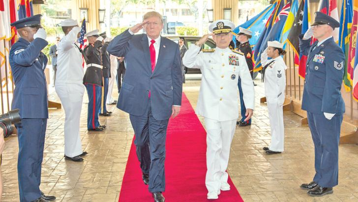 (File photo) President Donald J. Trump and US Pacific Command (USPACOM) Commander, Admiral Harry Harris  during an honours ceremony at USPACOM headquarters on November 3, 2017.