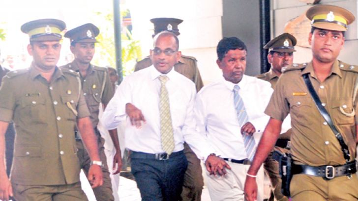 Former Chief of Presidential Staff K. Mahanama and former State Timber Corporation Chairman P. Dissanayake being taken to the prison from the Colombo Chief Magistrate's Court complex, Hulftsdorp. Picture by Wasitha Patabendige.