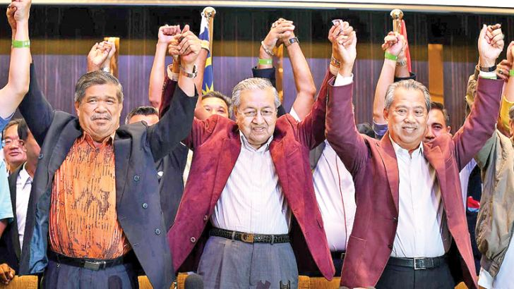 Former Malaysian Prime Minister and Opposition candidate Mahathir Mohamad (C) celebrates with other leaders of his coalition yesterday. - AFP