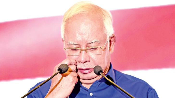 Outgoing Malaysian Prime Minister Najib Razak of the Barisan National party addresses the media after his party lost the 14th General Election in Kuala Lumpur on Tuesday. Najib was a former protege of  Mahathir Mohamad. - AFP