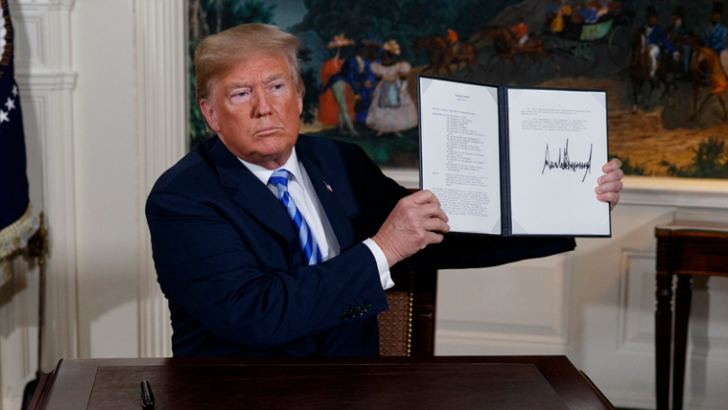 US President Donald Trump shows the signed Presidential memorandum on Tuesday that the US will withdraw from the 2015 accord to curb Iran's nuclear programme.