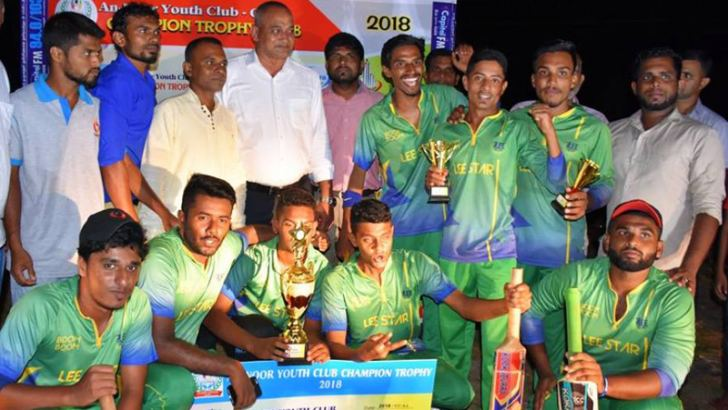 Akkaraipattu Lee Star SC's players celebrate with the trophy after winning against Addalaichenai Marksmen Sports Club in the final. Picture by I.L.M.RIZAN