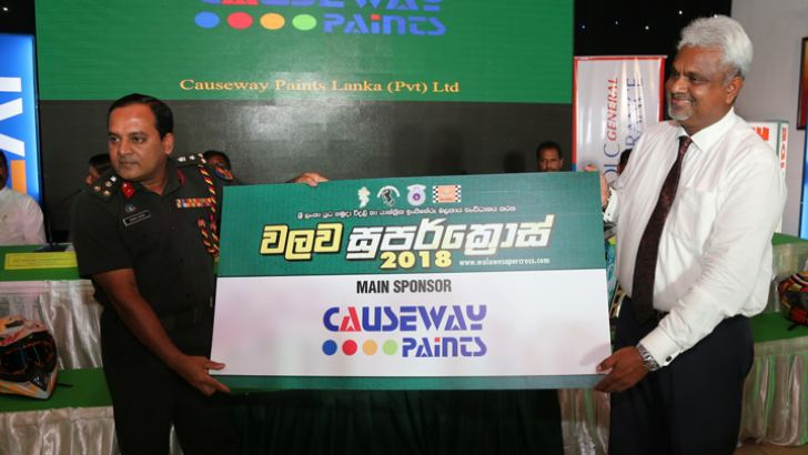 Causeway Paint Marketing Manager Nirmal Hettiarachci handing over the main sponsorship cheque to the Sri Lanka Electrical and Mechanical Engineers Regiment Colonel Commandant Brig. Duminda Sirinaga. Picture by Rukmal Gamage