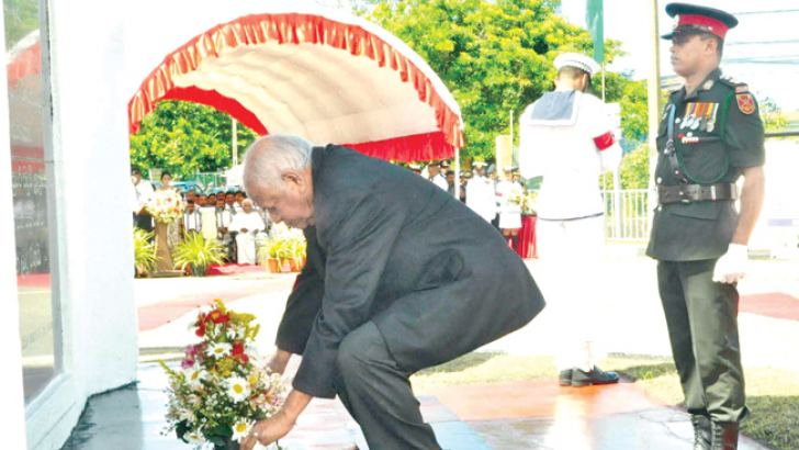 Southern Province Governor Marshall Perera, PC, pays tribute war heroes at the Galle Ranaviru Monument yesterday.