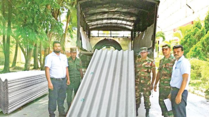 Officials of Sri Ramco Lanka handing over the stock of roofing sheets to the 14th Battalion of Vijayabahu Infantry Regiment.