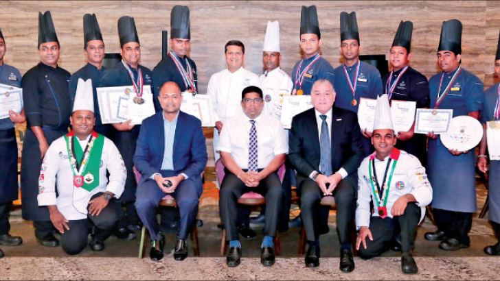The winners of competitions flagged by (seated L-R) Hilton Colombo, General Manager, Manesh Fernando, Hotel Developers PLC (Owning Company) Chairman, Krishantha Cooray and Hilton VP- Operations SEA, Paul Hutton, and Executive Chef, Kazi Hassan (standing center)