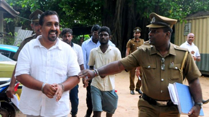 Former Parliamentarian Anuruddha Polgampola being taken to prisons from the Colombo Fort Magistrate Court premises recently. Picture by Wasitha Patabendige