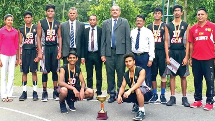 Squatting - Shewan Jayaweera, Thaaqib Amit, Standing (L-R) Hasanthika Dharmawardane (Assistant Coach), Daham Thennakoon, Indrajitha Bandara (Captain), Athula Jayawardane (Provincial Director of Sports and Physical Education – Kandy), S. Pathirage (Chief Guest – Assistant Director of Education- Financial Accountant), (Gladwin Canagasabey (Principal), Maj. B.Kohona (Head of Sports), Seshith Ariyawansa, Akaash Kathirvel, Anuradha Wijesinghe (MIC/Coach). Absent Navindu Weerasinghe, Dineth Ullandupitiya