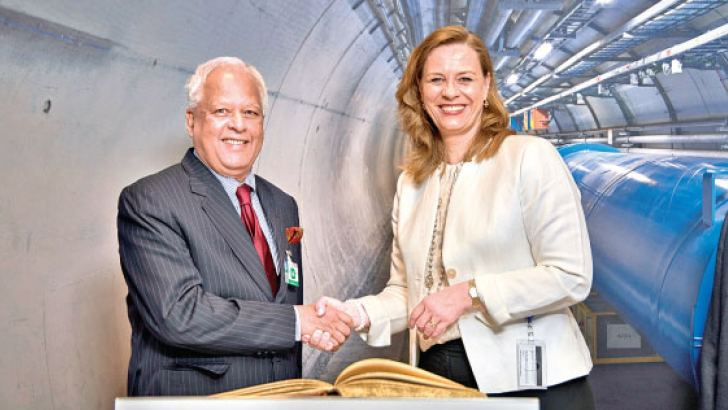 Minister Dr. Sarath Amunugama with Charlotte Warakaulle, Director for International Relations of CERN in Geneva