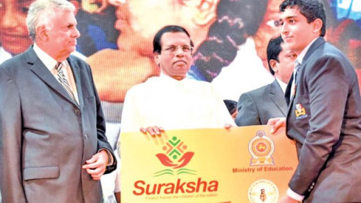 President Maithripala Sirisena and Prime Minister Ranil Wickremesinghe at the launch of the Suraksha healthcare insurance scheme in 2017.