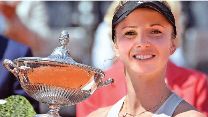Ukraine's Elina Svitolina poses with the trophy after winning the women's final against Romania's Simona Halep at Rome's WTA Tennis Open tournament at the Foro Italico, on May 20. AFP