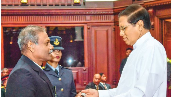 President Maithripala Sirisena, in his capacity as the Commander-in-Chief of the Armed Forces, awarded the Vishishta Seva Vibhushanaya (VSV) decoration to recognize the unblemished service to 50 Army, Navy and Air Force senior officers during a dignified ceremony at the Presidential Secretariat on Saturday to coincide with the National War Heroes' Day (May 19). Here, Associated Newspapers of Ceylon Limited's (ANCL) Deputy General Manager (Human Capital) retired Air Vice Marshal Lal Perera receiving his VSV