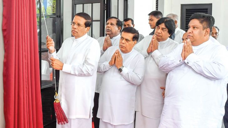 President Maithripala Sirisena unveiling the plaque while others look on. Picture by Sudath Silva