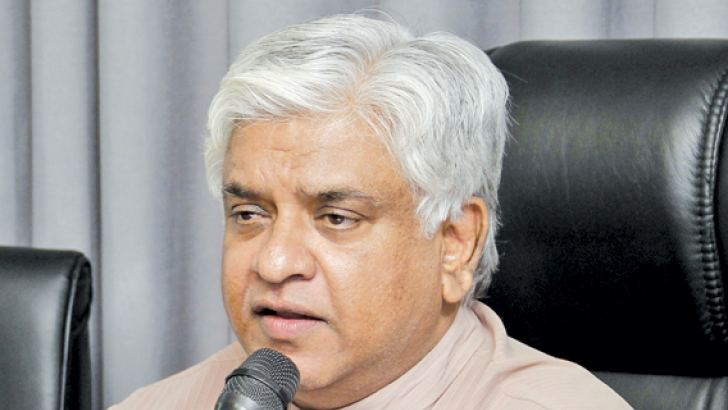 Minister Arjuna Ranatunga speaks at yesterday's event.  Picture by Roshan Pitipana