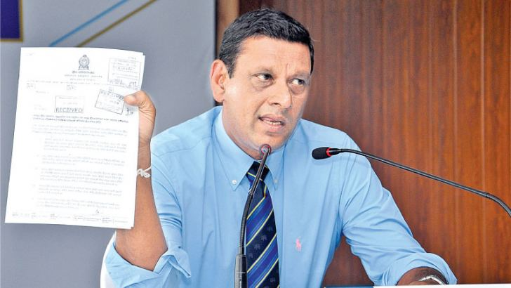 Ravin Wickramaratne addressing a media conference at SLC headquarters yesterday.