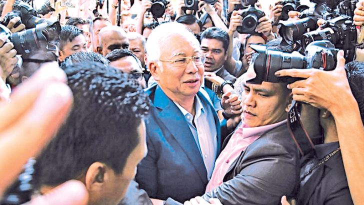 Malaysia's former Prime Minister Najib Razak  arrives at the Malaysian Anti-Corruption Commission's headquarters in Putrajaya, Malaysia yesterday. - BLOOMBERG