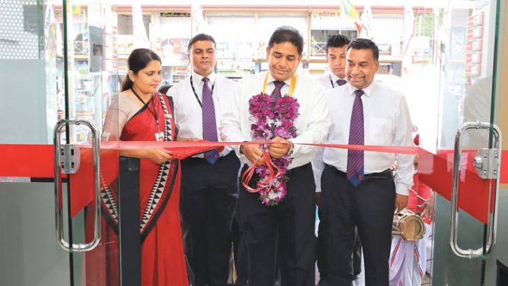 Seylan Bank Director and CEO Kapila Ariyaratne with other officials opening the Giriulla branch.