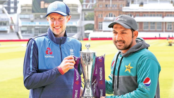England's captain Joe Root (L) and Pakistan's captain Sarfraz Ahmed pose with the trophy during a practice session at Lord's Cricket Ground in London on May 23 on the eve of the first Test match between England and Pakistan. AFP