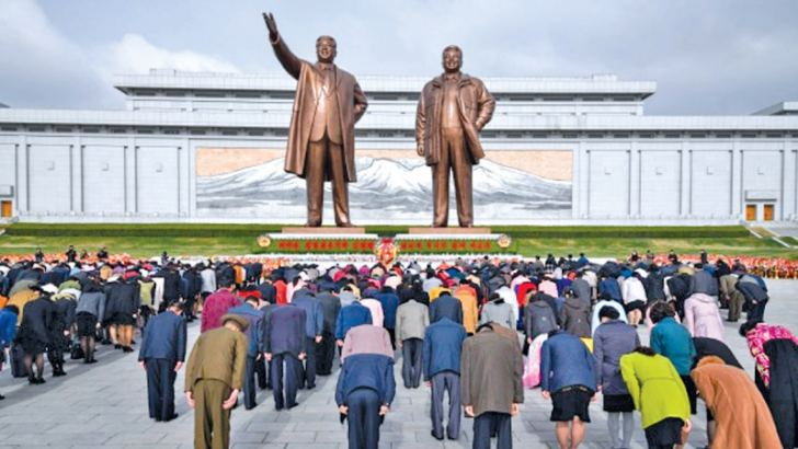 People bow as they pay their respects before the statues of late North Korean leaders Kim Il Sung and Kim Jong Il, at Mansu hill in Pyongyang. Thousands of North Korean devotees laid flowers before statues of the country's founder Kim Il Sung on the anniversary of his birth. Current leader Kim Jong Un is the third of the dynasty to head the nuclear-armed country. - AFP