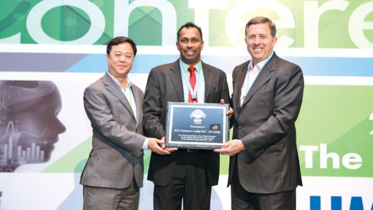 AIA Deputy CEO/ Chief Agency Officer Upul Wijesinghe receiving the award from Ian J Watts (Senior Vice President & Managing Director- LIMRA) and Andy Khoo (Managing Director- LIMRA).