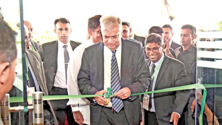 Prime Minister Ranil Wickremesinghe at the inauguration of the 'Build Sri Lanka 2018' exhibition, with Minister of Housing and Construction Sajith Premadasa and other officials.