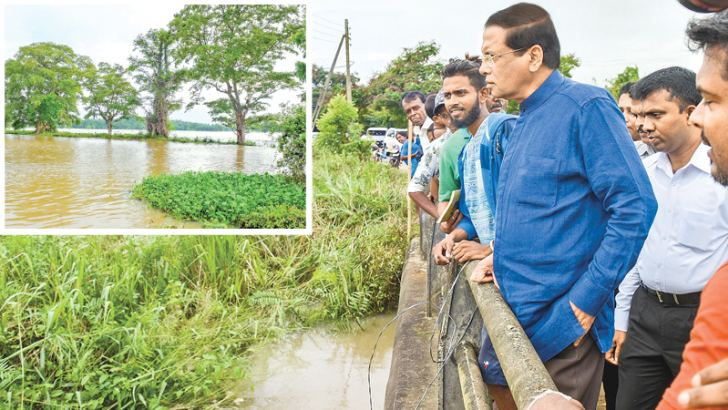 President Maithripala Sirisena during his  visit to Chilaw on an inspection tour of the  flood affected areas on May 26 afternoon.  Picture courtesy President's Media Division
