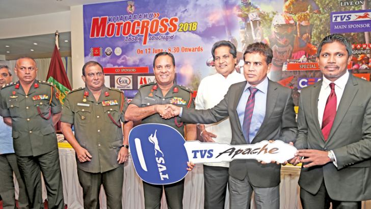 The Chief Executive Officer of TVS Lanka Ravi Liyanage symbolically handing over the key for the Vijayabahu Motocross - 2018 to Security Forces Commander of Kilinochchi Major General Ajith Kariyakarawana at the press conference held at Mirage Hotel, Wellawatta. Also in the picture is Event Director Upali Dassanayake. Picture by Rukmal Gamage