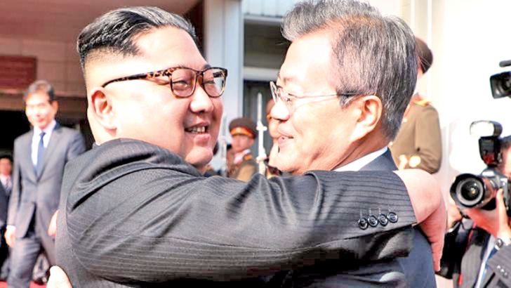 North Korean Leader Kim Jong Un,(L) and South Korean President Moon Jae-in embrace after Saturday's meeting at the DMZ.