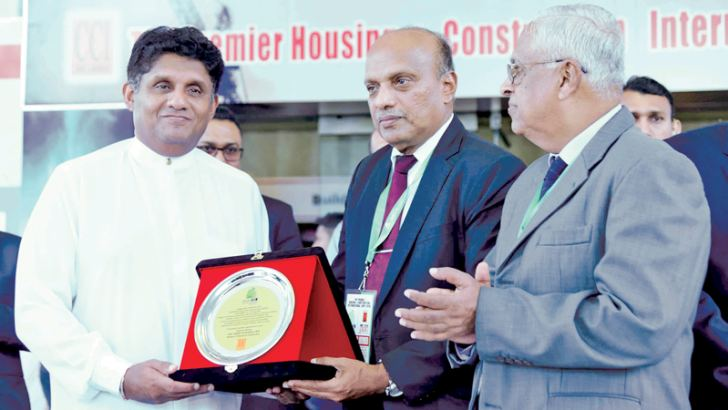 Chamber of Construction Industry Sri Lanka officials presenting a token  of appreciation to Minister Sajith Premadasa  Picture by Sulochana Gamage