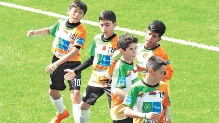 Dinuka Bandara young footballer from Sri Lanka (third from right) during a practice session