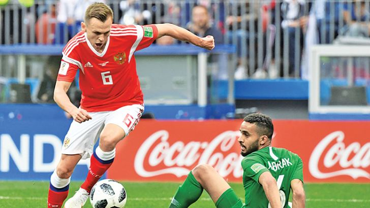 Russia's midfielder Denis Cheryshev (L) controls the ball before scoring their second goal during the Russia 2018 World Cup Group A football match between Russia and Saudi Arabia at the Luzhniki Stadium in Moscow on June 14. AFP