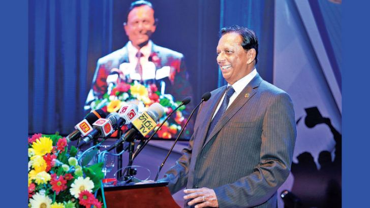 Minister John Amaratunge addressing the event at BMICH. Picture by Sudath Malaweera