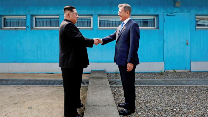 North Korean leader Kim Jong-un (L) shakes hands with South Korean President Moon Jae-in.