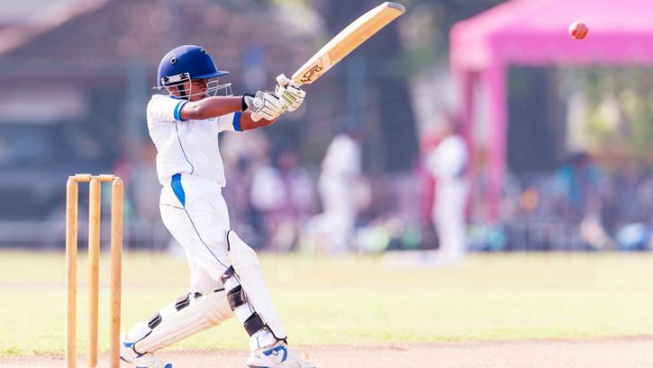 Santhul plays a pull shot during his century