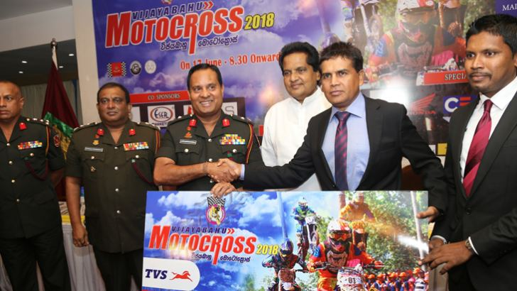 Ravi Liyanage (Fifth from left) the Chief Executive Officer of TVS Lanka Ltd. handing over the sponsorship cheque over to Major General Ajith Kariyakarawana (Third from left). Also in the picture are event Organizing Chairman Brigadier Chandana Gunawardena, Brigadier Srinath Ariyasinghe - Regimental Commander of Kurunegala Boyagane VIR headquarters and Upali Dissanayake CEO of (SLARDAR) and other officials. Picture by Rukmal Gamage