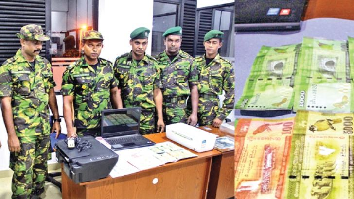 The STF personnel with the seized equipment and currency notes.