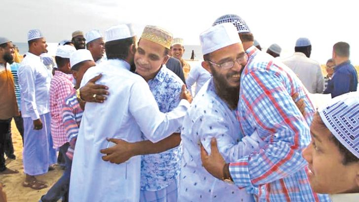 The Muslim community wishing each other. Picture by I. L. M. Rizan, Addalaichenai Central Corr.
