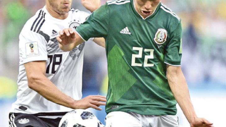 Germany's defender Joshua Kimmich (L) vies for the ball with Mexico's forward Hirving Lozano during the Russia 2018 World Cup Group F football match between Germany and Mexico at the Luzhniki Stadium in Moscow on June 17. AFP