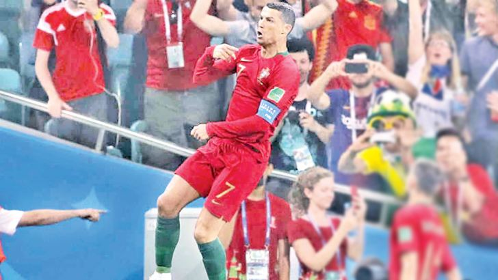 Portugal captain Cristiano Ronaldo celebrates his hat-trick against Spain.