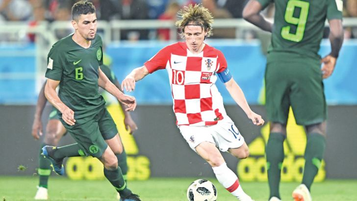 Croatia's midfielder Luka Modric (C) and Nigeria's defender Leon Balogun vie for the ball during the Russia 2018 World Cup Group D football match at the Kaliningrad Stadium in Kaliningrad on Saturday, - AFP