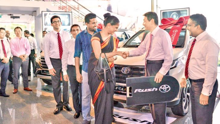 Toyota Lanka's Managing Director Shungo Yoshioka presenting the dummy keys to on of  the first customers