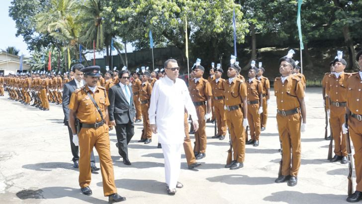 Minister Mahinda Samarasinghe inspecting security personnel during the ceremony.