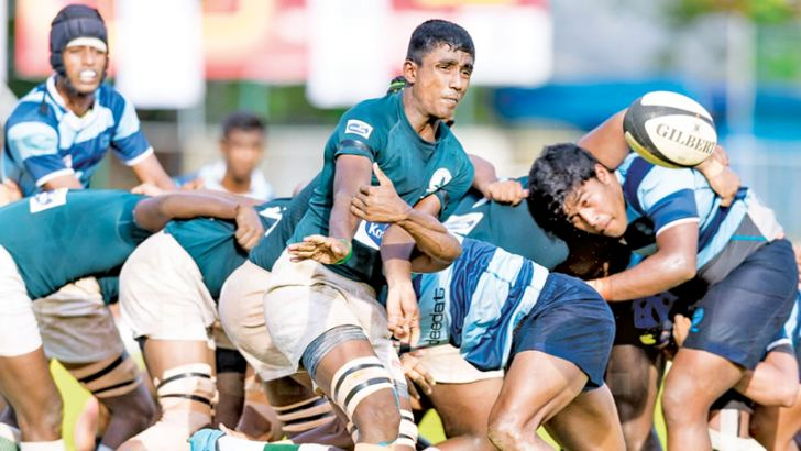 A tussle for the ball between Wesley and Isipathana players in the knockout schools rugby quarterfinal played at Sugathadasa Stadium yesterday.