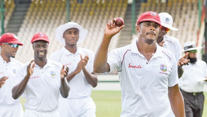 Shannon Gabriel (R) of West Indies celebrates taking 8 wickets for 62 runs during day 5 of the 2nd Test between West Indies and Sri Lanka at Daren Sammy Cricket Ground, Gros Islet, St. Lucia, on June 18. AFP